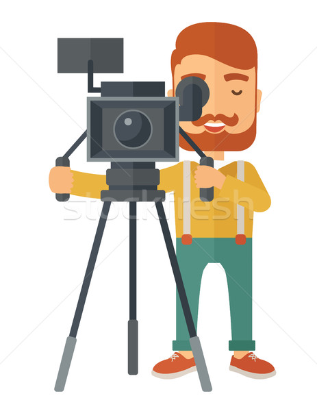 Videographer and his video cam with tripod. Stock photo © RAStudio