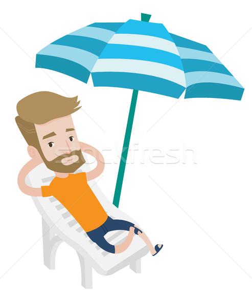 Adam rahatlatıcı şezlong oturma Stok fotoğraf © RAStudio