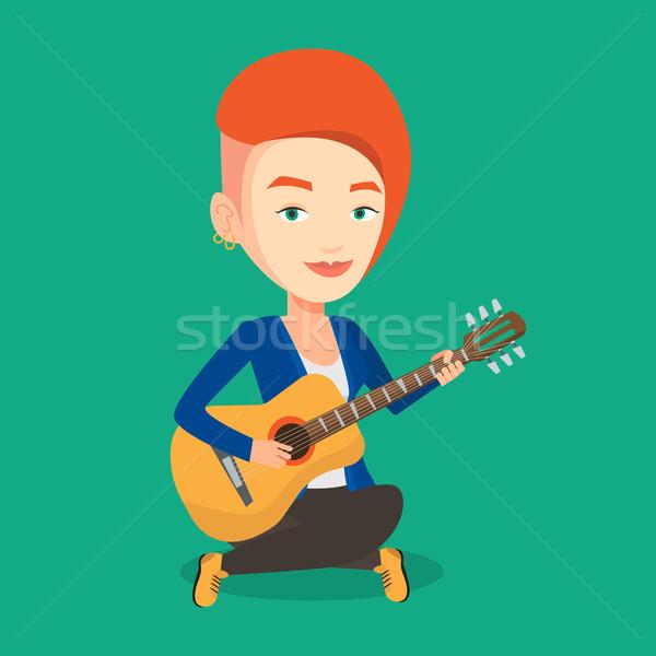 Mujer jugando guitarra acústica amistoso músico sesión Foto stock © RAStudio