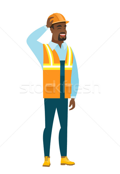 Young african-american builder scratching his head Stock photo © RAStudio