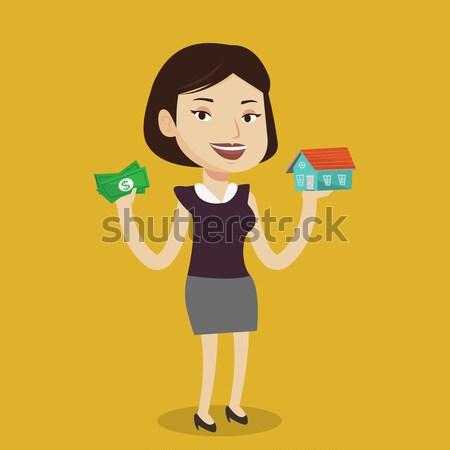 Mujer compra casa gracias préstamo Asia Foto stock © RAStudio