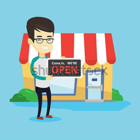 Asia tienda propietario abierto alegre Foto stock © RAStudio