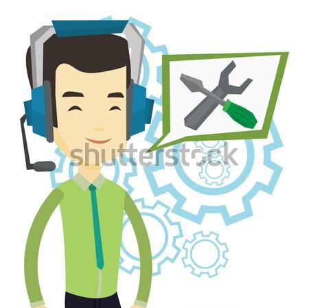 Teknik destek operatör genç kulaklık ayarlamak Stok fotoğraf © RAStudio