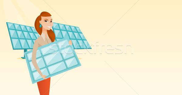 Vrouw zonnepaneel kaukasisch werknemer Stockfoto © RAStudio