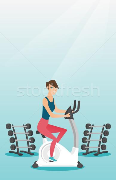 Fiatal nő lovaglás mozdulatlan bicikli kaukázusi nő Stock fotó © RAStudio