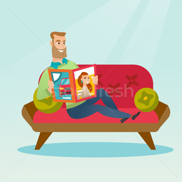 Man reading a magazine on the couch. Stock photo © RAStudio