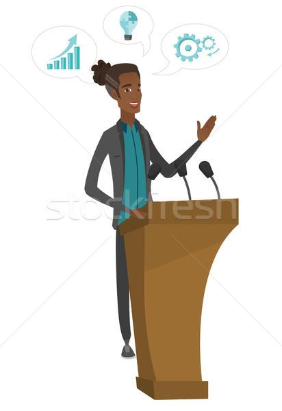 African politician giving a speech from tribune. Stock photo © RAStudio