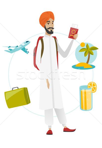Young man traveler holding passport with ticket. Stock photo © RAStudio