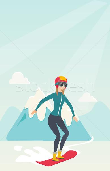 Young caucasian woman snowboarding. Stock photo © RAStudio