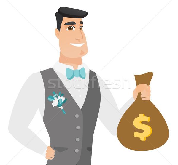 Fiatal kaukázusi vőlegény mutat pénz táska Stock fotó © RAStudio