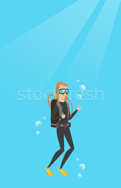 Young caucasian scuba diver giving thumb up. Stock photo © RAStudio