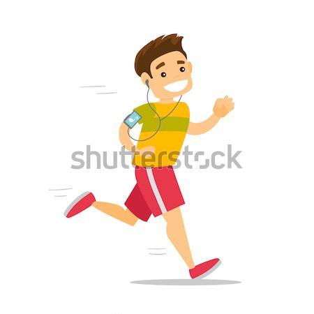 Young man running with earphones and smartphone. Stock photo © RAStudio