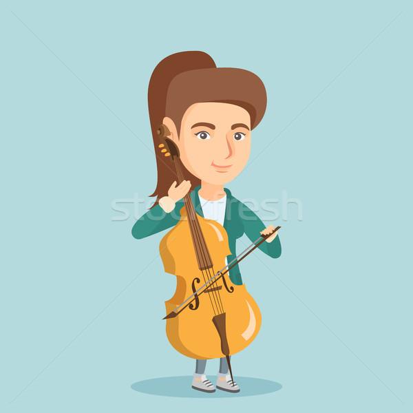 Młodych kobieta gry wiolonczela muzyk Zdjęcia stock © RAStudio