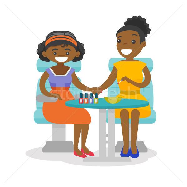 African donna manicure salone di bellezza giovani pittura Foto d'archivio © RAStudio