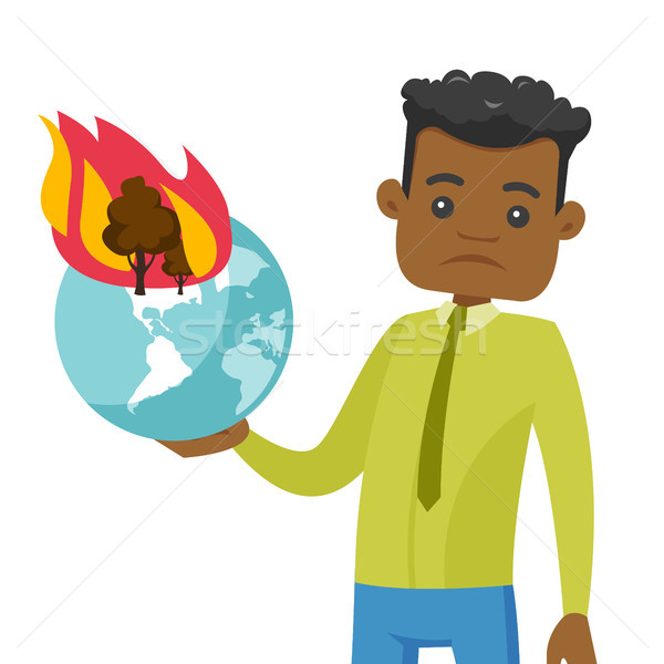 African man holding globe with forest in fire. Stock photo © RAStudio