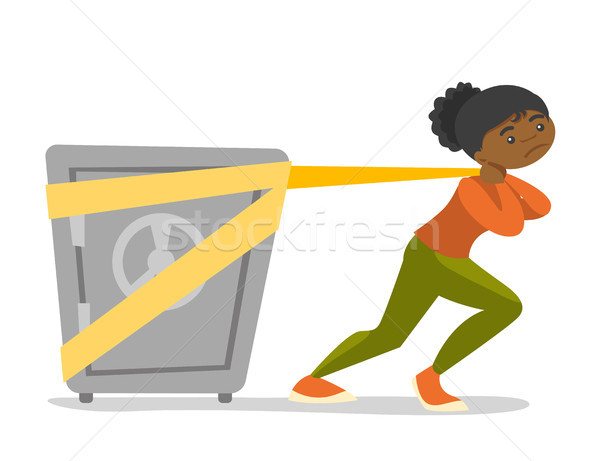 African-american college student pulling a safe. Stock photo © RAStudio