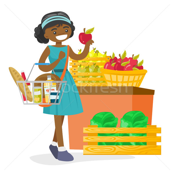 Young african-american woman buying products. Stock photo © RAStudio