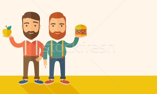 Two businessmen comparing apple to hamburger. Stock photo © RAStudio