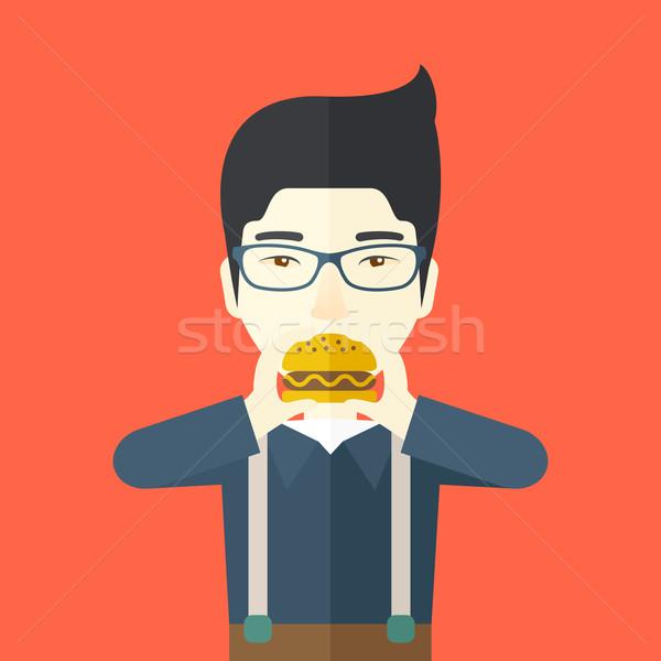Stockfoto: Man · eten · hamburger · gelukkig · asian