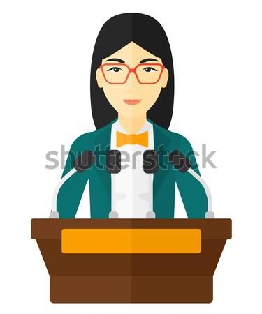 Man speaking on podium. Stock photo © RAStudio