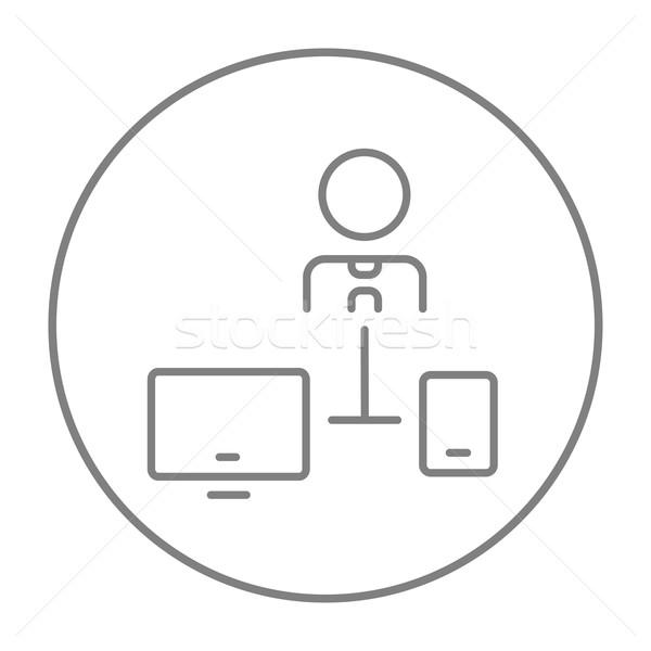 Man linked with computer and phone line icon. Stock photo © RAStudio