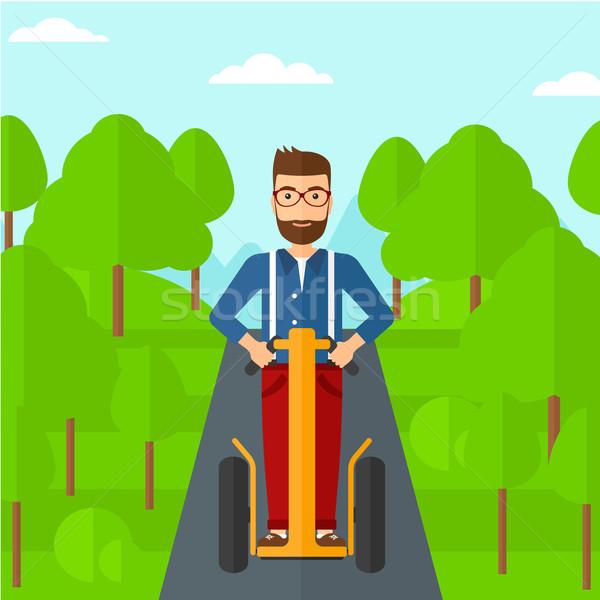 Man riding on electric scooter. Stock photo © RAStudio