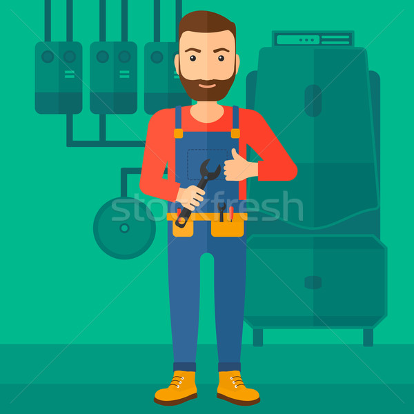 Cheerful repairer with spanner. Stock photo © RAStudio