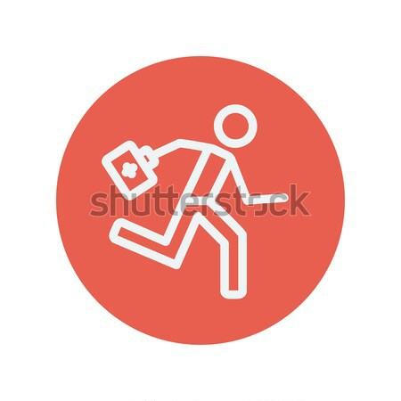 Paramedic running with first aid kit line icon. Stock photo © RAStudio