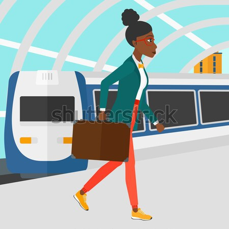 Woman going out of train. Stock photo © RAStudio