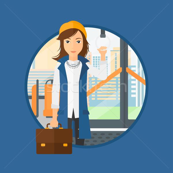 Vrouw openbaar vervoer jonge vrouw permanente binnenkant Stockfoto © RAStudio