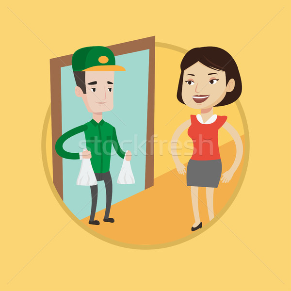 Delivery man delivering groceries to customer. Stock photo © RAStudio