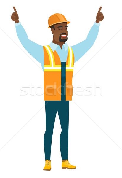 Builder standing with raised arms up. Stock photo © RAStudio