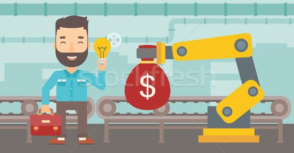 Man selling idea of engineering of robotic hand. Stock photo © RAStudio