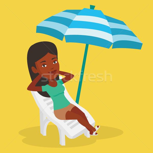 Kadın rahatlatıcı şezlong oturma tatil Stok fotoğraf © RAStudio