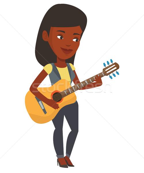Vrouw spelen akoestische gitaar muzikant permanente gitaar Stockfoto © RAStudio