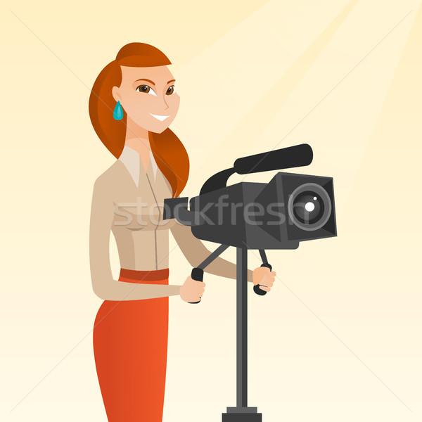 Cameraman with movie camera on tripod. Stock photo © RAStudio