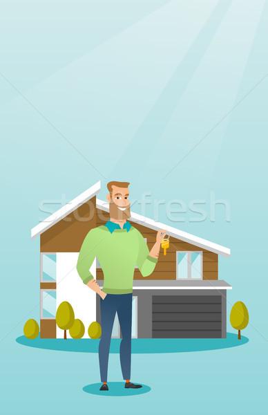 Jonge kaukasisch huiseigenaar sleutel gelukkig nieuwe Stockfoto © RAStudio