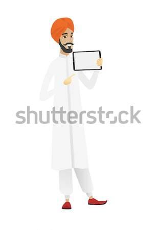 Smiling businessman holding tablet computer. Stock photo © RAStudio