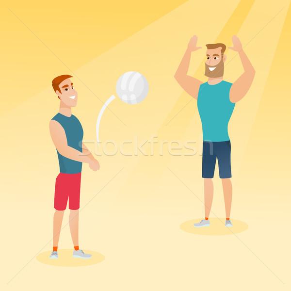 Two caucasian men playing beach volleyball. Stock photo © RAStudio