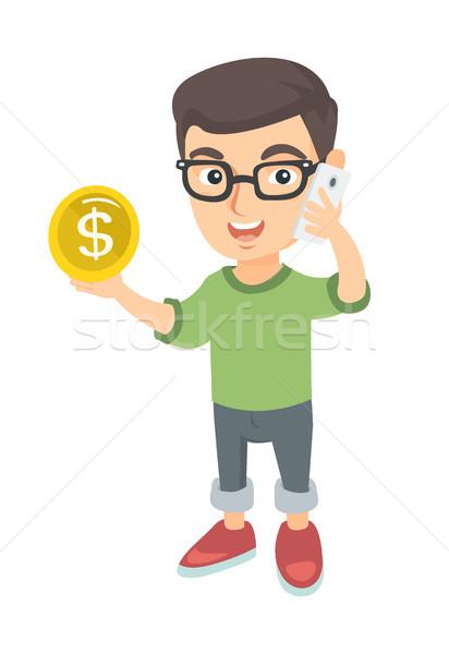 Boy businessman talking on phone and holding coin. Stock photo © RAStudio