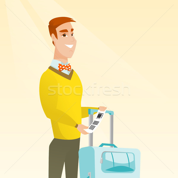 Stock photo: Caucasian businessman showing luggage tag.