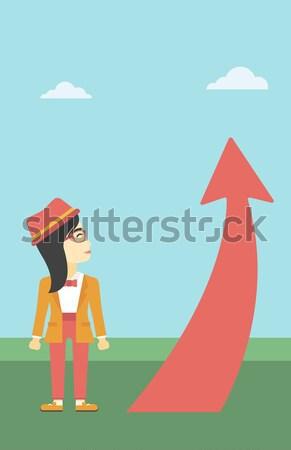Business woman looking at arrow going up. Stock photo © RAStudio