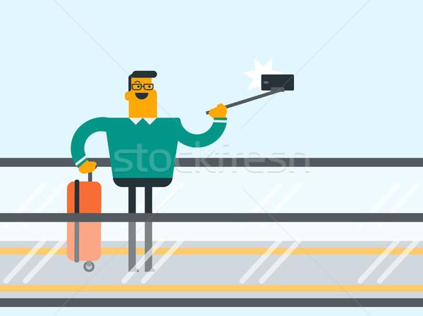 Man smartphone roltrap luchthaven jonge kaukasisch Stockfoto © RAStudio