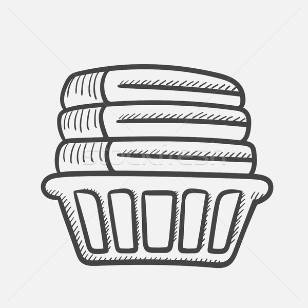 Basket with linen hand drawn sketch icon. Stock photo © RAStudio