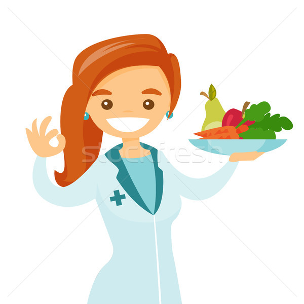 Caucasian white dietician offering healthy food. Stock photo © RAStudio