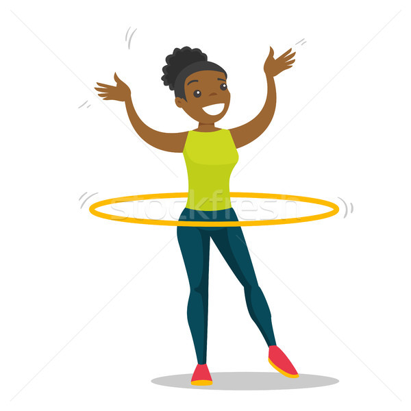 Young african woman doing exercises with hula hoop Stock photo © RAStudio