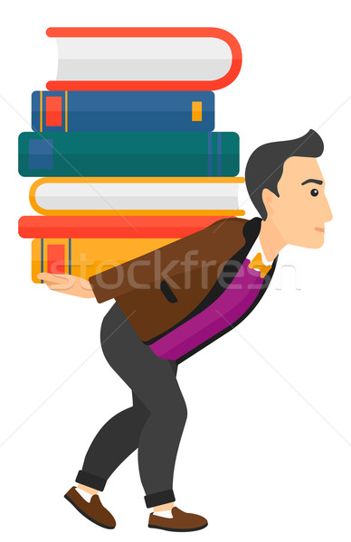 Man with pile of books. Stock photo © RAStudio