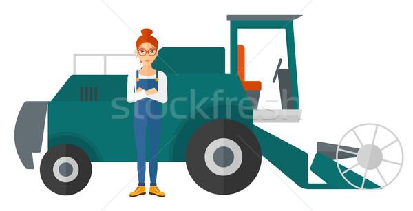 Woman standing with combine on background. Stock photo © RAStudio