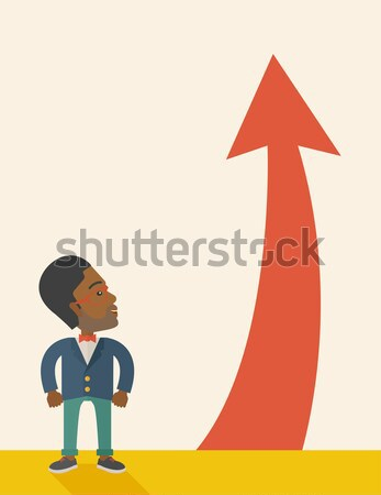 Man with arrow going up. Stock photo © RAStudio