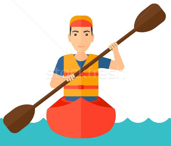 Man riding in canoe. Stock photo © RAStudio
